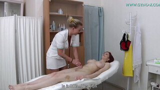Redheaded beauty gets fingered and fucked by a nurse